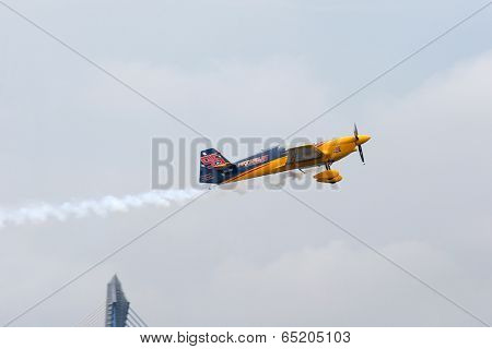 PUTRAJAYA, MALAYSIA - MAY 17, 2014: Matt Hall from Australia in a MXS-R plane flies in the skies of Putrajaya, Malaysia during the qualifying session of the Red Bull Air Race World Championship 2014.