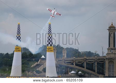 PUTRAJAYA, MALAYSIA - MAY 16, 2014: Paul Bonhomme takes his Edge 540 V3 plane up on a loop after passing the final pylons during a training session preparing for the Red Bull Air Race Putrajaya 2014.