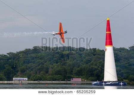 PUTRAJAYA, MALAYSIA - MAY 17, 2014: Nicolas Ivanoff from France in an Edge 540 V2 plane flies through the race course over Putrajaya lake at the Red Bull Air Race World Championship 2014.