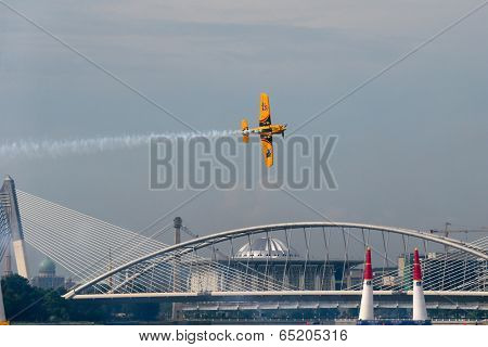 PUTRAJAYA, MALAYSIA - MAY 17, 2014: Matt Hall from Australia in a MXS-R plane flies through the race course over Putrajaya lake during the Red Bull Air Race World Championship 2014.