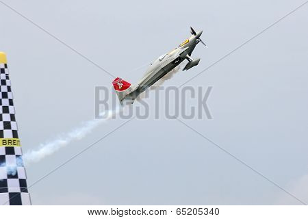 PUTRAJAYA, MALAYSIA - MAY 17, 2014: Yoshihide Muroya from Japan in an Edge 540 V2 plane flies through the race course during the qualifying session of the Red Bull Air Race World Championship 2014.