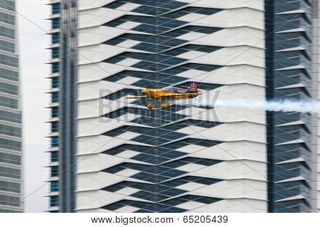 PUTRAJAYA, MALAYSIA - MAY 17, 2014: Matt Hall from Australia in a MXS-R plane flies through the race course over Putrajaya lake at the Red Bull Air Race World Championship 2014.