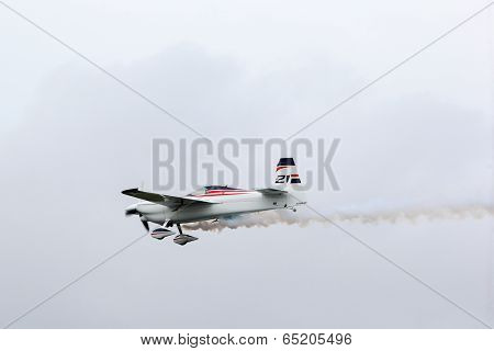PUTRAJAYA, MALAYSIA - MAY 17, 2014: Matthias Dolderer from Germany, flying an Edge 540 v3 plane takes to the skies at the qualifying session of the Red Bull Air Race World Championship Putrajaya 2014.