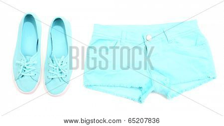 Women color shorts and shoes isolated on white