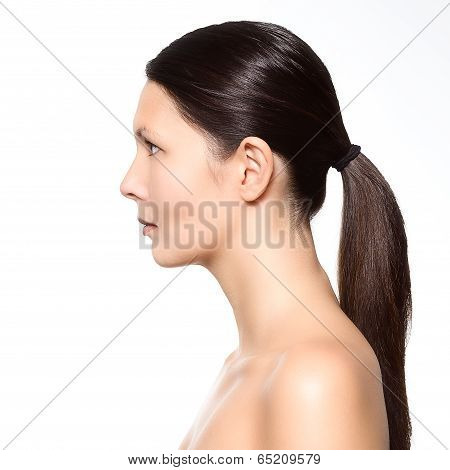 Naked Young Woman Standing In Profile