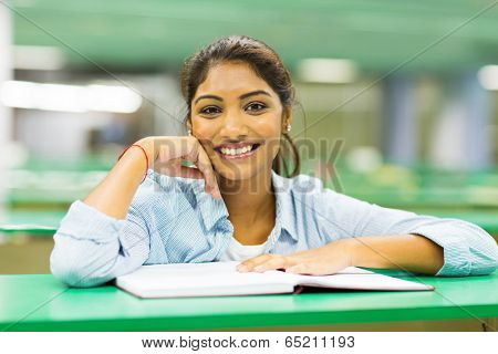 pretty indian college student in library