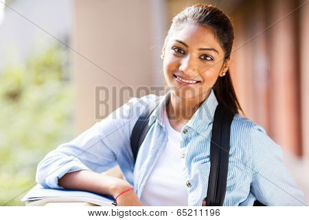 portrait of attractive female university student standing by hallway