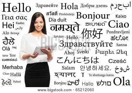 Young attractive woman with and over the background with a different world languages (language school concept)