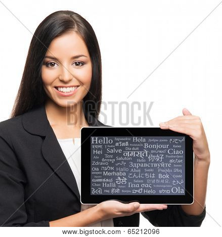 Young, confident, successful and beautiful business woman with the tablet computer with a different world languages on a display