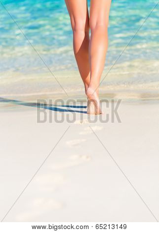 Closeup photo of sexy woman legs, body part, slim female walking on the beach, carefree lifestyle, summer vacation, relaxation concept