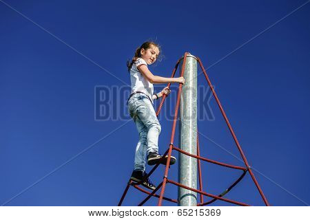 Teenage Girl Playing On Child Playground