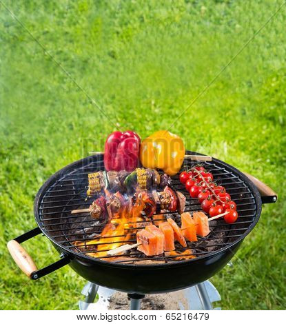 Meat and vegetable on barbecue grill with fire