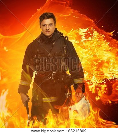 Firefighter with helmet and axe in a flame