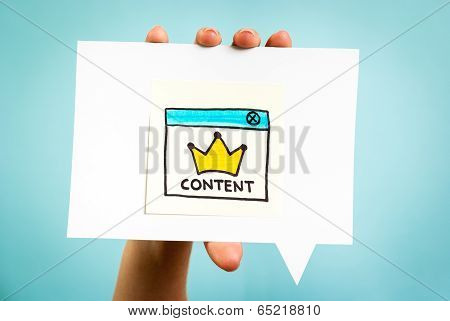 Hand holding a speech bubble with the word content  and yellow crown on blue background.