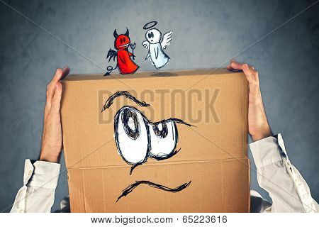 Businessman With A Cardboard Box And Angel And Devil On His Head