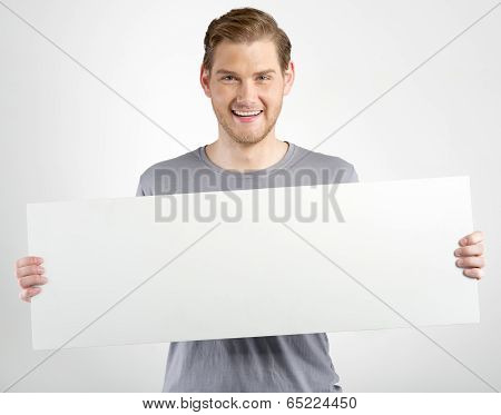 Man Holding Sign