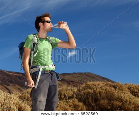 Hiker Drinking Water