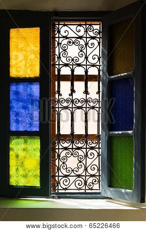 Open Window With Colored Glass And Arabic Grill In Marrakesh