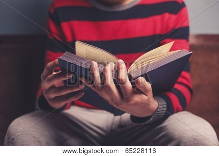 Man Is Reading A Big Book