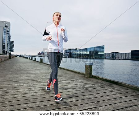 Beautiful Young Female Running On The Boardwalk