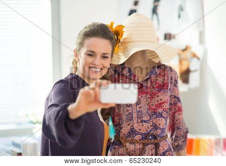 Happy Fashion Designer Taking Self Photo With Garment