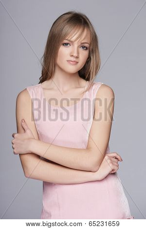 Feminine teen girl  in pink dress posing