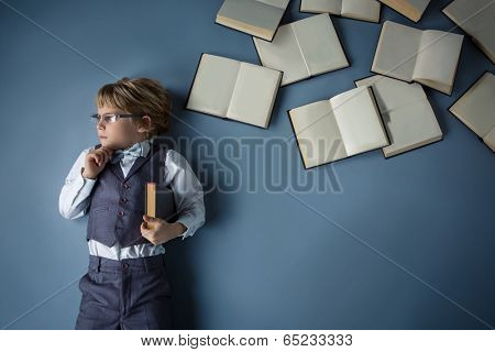 Little boy with books in studio