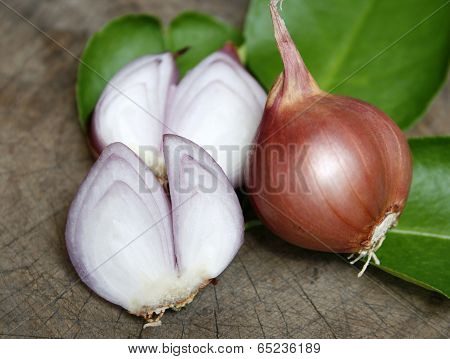 Sliced Shallot With Whole Shallots On Wooden