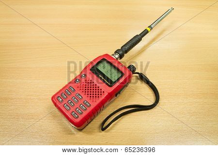 Vhf Fm Transceiver On Wooden Table Background