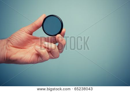 Hand Holding Polarizer Filter
