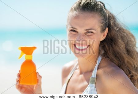 Happy Young Woman Showing Sun Block Creme
