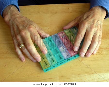 Elderly Hands Holding Pill Container