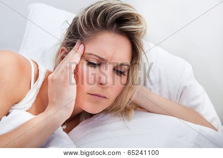 Portrait Of Woman With Headache