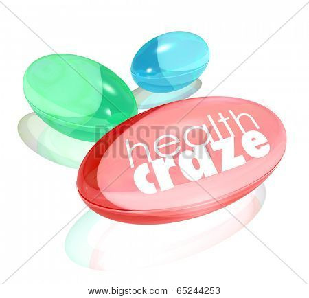 Health Craze words on vitamin supplement capsules nutritional pills