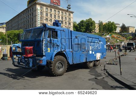 KIEV, UKRAINE - APR 29, 2014: Downtown of Kiev.  Police water cannon truck captured by rioters on the main street. Putsch of Junta in Kiev. Kiev.April 29, 2014 Kiev, Ukraine