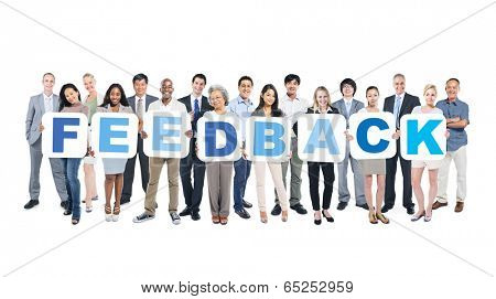 Group Of Happy Multi-Ethnic Business People Holding The Word Feedback