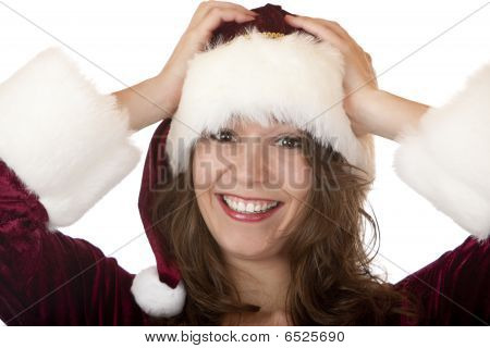 Young Attractive Woman With Christmas Santa Claus Dress Holds Fur Cap