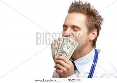 Young Happy Male medical Doctor Kissing holdin and kissing US Dollar Bills