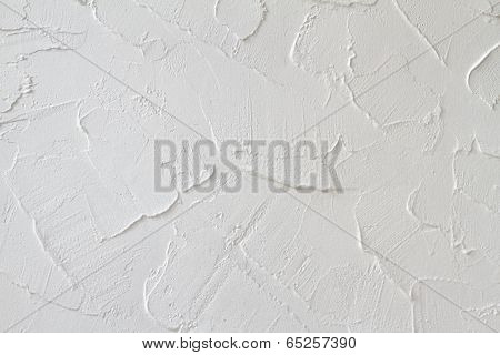 White painted plaster effect on wall