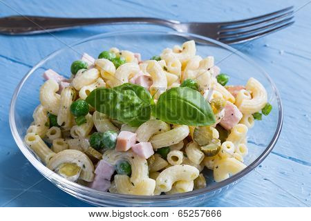 Pasta Salad In A Glass Bowl On Blue Wood