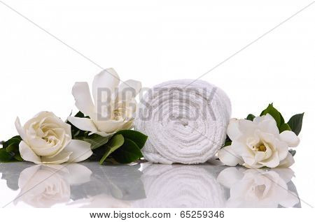 Still life with three gardenia with roller towel