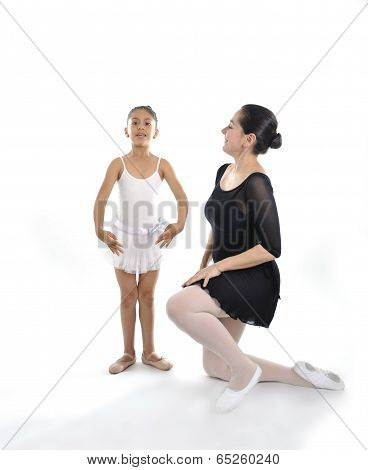 Young Little Girl Ballerina Learning Dance Lesson With Ballet Teacher