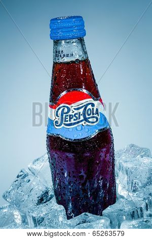 MOSCOW, RUSSIA-APRIL 4, 2014: Bottle of Pepsi cola on ice. Pepsi is a carbonated soft drink that is produced and manufactured by PepsiCo. Created and developed in 1893.