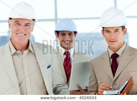 A Group Of Architect Smiling At The Camera