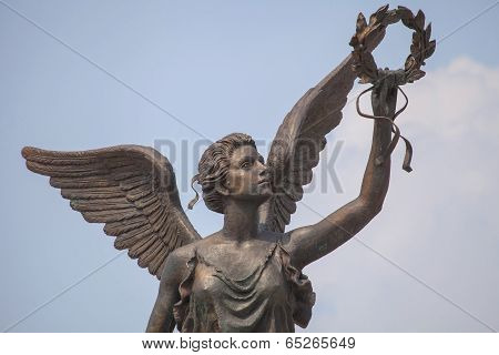 Detail of monument to goddess of victory Nike against the sky.