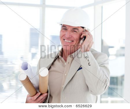 Close-up Of A Senior Architect On Phone