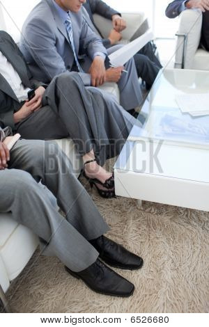 Close-up Of Business People In A Waiting Room
