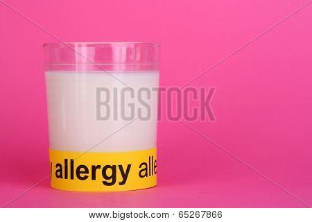Milk allergy on pink background