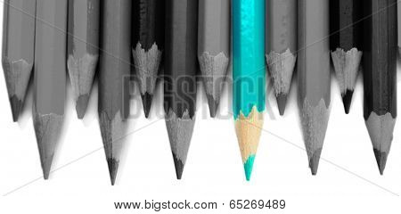 Concept of individuality.One bright color pencil among grey pencils