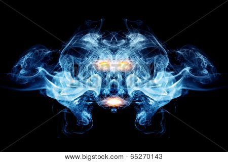 Abstract face made of smoke, flames. May be the concept of ghost, devil, logo element, background